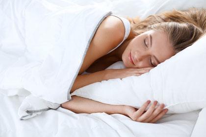 Woman sleeping peacefully in bed after sleep apnea treatment